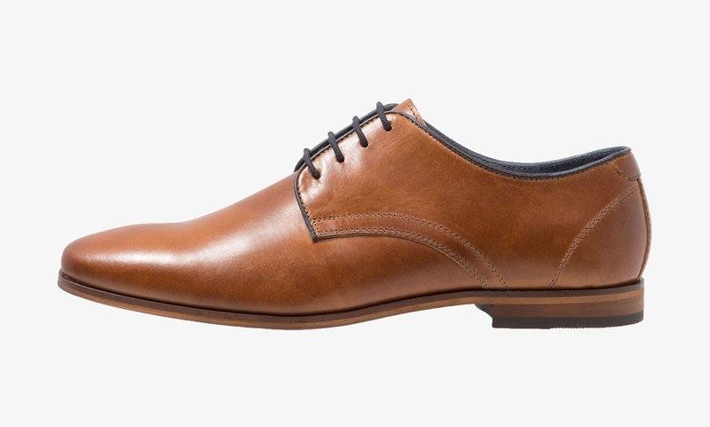 Scarpe eleganti e stringate da uomo